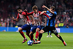 Atletico de Madrid's Diego Costa (L) and Antoine Griezmann (R) and Club Brugge's Mats Rits during UEFA Champions League match between Atletico de Madrid and Club Brugge at Wanda Metropolitano Stadium in Madrid, Spain. October 03, 2018. (ALTERPHOTOS/A. Perez Meca)