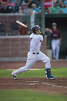 Idaho Falls Chukars right fielder Jose Caraballo (6) follows through on his swing during a Pioneer League game against the Great Falls Voyagers at Melaleuca Field on August 18, 2018 in Idaho Falls, Idaho. The Idaho Falls Chukars defeated the Great Falls Voyagers by a score of 6-5. (Zachary Lucy/Four Seam Images)