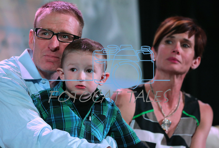 An emotional Scott and Kristi Young watch a video about their 3-year-old son Isaac at the Make-A-Wish Waffles & Wishes event at the Atlantis Casino Resort Spa in Reno, Nev., on Tuesday, March 26, 2013. Isaac is fighting liver cancer and was granted a wish of a road trip to California during the 30th anniversary event..Photo by Cathleen Allison