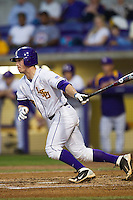 LSU Tigers shortstop Alex Bregman #30 follows through on his swing against the Auburn Tigers in the NCAA baseball game on March 22nd, 2013 at Alex Box Stadium in Baton Rouge, Louisiana. LSU defeated Auburn 9-4. (Andrew Woolley/Four Seam Images).