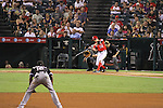 Peter Bourjos of the Angels makes contact against the White Sox.