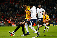 Shawn McCoulsky of Newport County is challenged by Danny Rose of Tottenham Hotspur during the Fly Emirates FA Cup Fourth Round Replay match between Tottenham Hotspur and Newport County at Wembley Stadium, London, England, UK. 07 February 2018