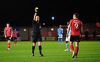 Lincoln City's Tom Hopper is shown a yellow card by referee Carl Boyeson<br /> <br /> Photographer Chris Vaughan/CameraSport<br /> <br /> EFL Papa John's Trophy - Northern Section - Group E - Lincoln City v Manchester City U21 - Tuesday 17th November 2020 - LNER Stadium - Lincoln<br />  <br /> World Copyright © 2020 CameraSport. All rights reserved. 43 Linden Ave. Countesthorpe. Leicester. England. LE8 5PG - Tel: +44 (0) 116 277 4147 - admin@camerasport.com - www.camerasport.com