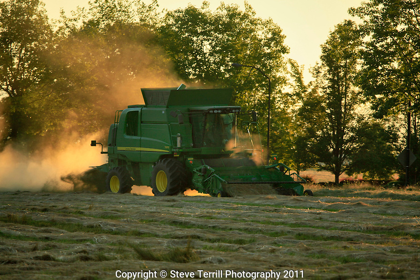 Combine working the field at dusk in the Willamette Valley Oregon