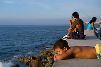 People, couples, on the oceanfront Malecon.