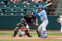 Tennessee Smokies outfielder Albert Almora (6) at bat in front of catcher Justin O'Conner and umpire Alex Ransom during a game against the Montgomery Biscuits on May 25, 2015 at Riverwalk Stadium in Montgomery, Alabama.  Tennessee defeated Montgomery 6-3 as the game was called after eight innings due to rain.  (Mike Janes/Four Seam Images)