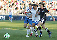 Sonia Bompastor #8 of the Washington Freedom races after a loose ball with Alex Scott #22 and Amy LePelbet #6 of the Boston Breakers during a WPS match at the Maryland Soccerplex, in Boyd's, Maryland, on April 18 2009. Breakers won the match 3-1.