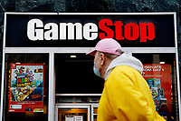 NEW YORK, NEW YORK - FEBRUARY 25: A man looks at GameStop at 6th Avenue on February 25, 2021 in New York. GameStop Corp. doubled its shares and and jumped another 19% today and the betting are that GameStop shares would spike to $800 on Friday. (Photo by John Smith/VIEWpress via Getty Images)