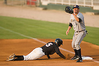 First baseman Luke Murton #34 of the Charleston RiverDogs waits for the throw as Daniel Wagner #5 of the Kannapolis Intimidators dives bag to the bag at Fieldcrest Cannon Stadium May 29, 2010, in Kannapolis, North Carolina.  Photo by Brian Westerholt / Four Seam Images