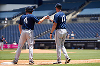 Lakeland Flying Tigers Colt Keith (4) fist bumps manager Andrew Graham (17) during a game against the Tampa Tarpons on July 18, 2021 at George M. Steinbrenner Field in Tampa, Florida.  (Mike Janes/Four Seam Images)
