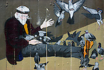 STREET MURAL: painting depicting a homeless man feeding pigeons