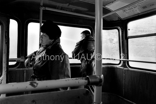Norilsk, Russia  .May-June 1997.Riding the bus through the bleak and cold nickel mining city if Norilsk. It snows until mid-June and begins again in late August. The days and nights are either all dark or all light depending on the time of year..