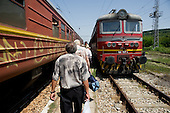 Passengers disembark from a train at a small rural station in central Bulgaria