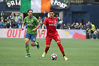 SEATTLE, WA - NOVEMBER 10: Marky Delgado #8 of Toronto FC is chased by Gustav Svensson #4 of the Seattle Sounders FC during a game between Toronto FC and Seattle Sounders FC at CenturyLink Field on November 10, 2019 in Seattle, Washington.