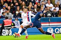 19th September 2021: Le Parc des Princes, Paris, France; French League 1 football Paris Saint Germain versus Olympique Lyonnais:   Jeff Reine Adelaide OL challenged by Nuno Mendes PSG