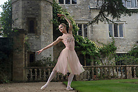 BNPS.co.uk (01202) 558833.<br /> Pic: ZacharyCulpin/BNPS<br /> <br /> Principal dancer with The Royal Ballet, Anna Rose O'Sullivan limbers up before taking to the stage in the stunning grounds of the 500 year old  Athelhampton House last week. Anna was taking part in a fundraising ballet show at the Tudor Manor House in the Dorset countryside.