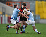 Morgan Garry of Ennis  in action against Jack Hennessy and Harry Byrne of Garryowen during their U-18 Munster Club Final at Thomond Park. Photograph by John Kelly.