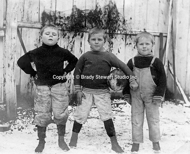 East McKeesport PA:  Three boys from Brady Stewart's neighborhood getting ready for a football game.  The 3 horsemen of East McKeesport!