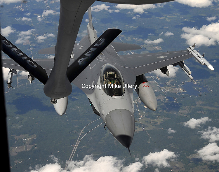 Staff Photo/Mike Ullery, Piqua Daily Call.An Ohio Air National Guard F-16 from the 180th Fighter Wing out of Toledo, Ohio eases up to the boom of a KC-135  from the 121st Air Refueling Wing out of Rickenbacker Air Base in Columbus on July 16, 2009. The rendevous point over northern Michigan was part of a media orientation flight hosted by the Ohio National Guard at Rickenbacker.