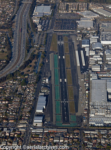 aerial photograph of Hawthorne Municipal Airport, Jack Northrup Field (HHR), Hawthorne, Los Angeles County, California.  SpaceX Facilities and a Tesla Design Center are at the right of the photograph, interstate 105 at the left