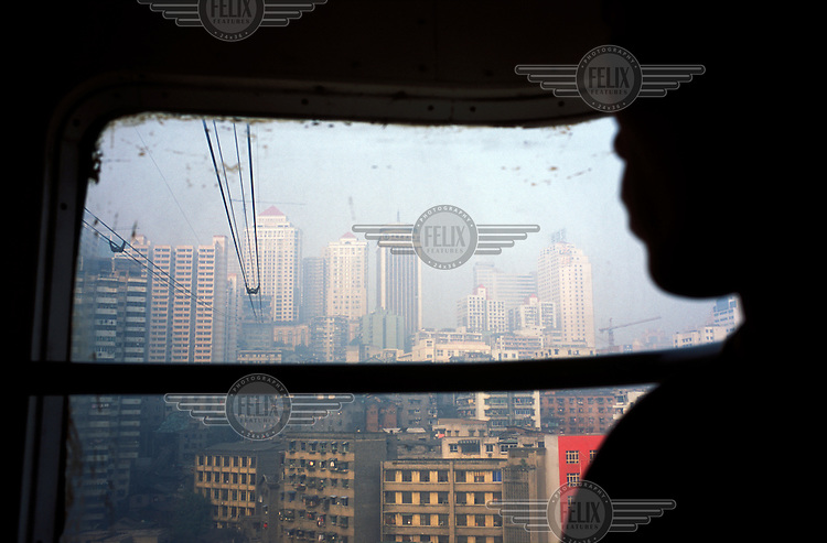View of city from cable car across the Yangtze River...