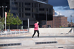 A jogger runs through the Pier Head area in Liverpool