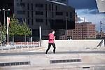 A jogger runs through the Pier Head area in Liverpool