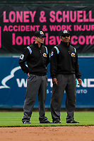 Third base umpire Clayton Hamm (left) and first base umpire Javerro January (right) talk things over between innings during a Pacific Coast League game between the San Antonio Missions and the Iowa Cubs on May 2, 2019 at Principal Park in Des Moines, Iowa. Iowa defeated San Antonio 8-6. (Brad Krause/Four Seam Images)