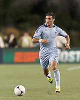 Sporting Kansas City substitute forward Soony Saad (22) brings the ball forward. In a Major League Soccer (MLS) match, Sporting Kansas City defeated the New England Revolution, 1-0, at Gillette Stadium on August 4, 2012.