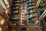 Pictured: The finished HOPE candle feature at Salisbury cathedral. <br /> <br /> As we approach the one year anniversay since the UK went in to its first lockdown due to COVID-19, Salisbury cathedral has set up a lit candle feature as a sign of encouragement for the public. The feature, which used 1,000 candles in total, is meant to inspire hope as the government's plans for the UK to leave its third and final lockdown are implemented. <br /> <br /> The temporary feature has been set up during a free day from its vaccination schedule, which has been taken place at the cathedral since 16th January. An estimated 1,000 daily vaccinations take place at Salisbury cathedral on three scheduled days a week, approaching 20,000 inoculations since the scheme began.<br /> <br /> © Ewan Galvin/Solent News & Photo Agency<br /> UK +44 (0) 2380 458800