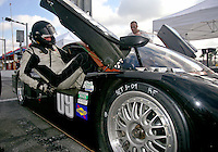 Driver Derek Johnston climbs in tot he #09 Porsche Coyote during December testing at Daytona International Speedway as teams prepare for the upcoming Rolex 24 at Daytona, December 9, 2009, Daytona bech, FL. (Photo by Brian Cleary/www.bcpix.com)