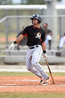 Miami Marlins second baseman Avery Romero (14) during a minor league spring training game against the New York Mets on March 28, 2014 at the Roger Dean Stadium Complex in Jupiter, Florida.  (Mike Janes/Four Seam Images)