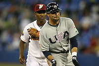 March 8, 2009:  Left fielder - third baseman Mark DeRosa (7) of Team USA reacts after a tripe in front of Melvin Mora (6) during the first round of the World Baseball Classic at the Rogers Centre in Toronto, Ontario, Canada.  Team USA defeated Venezuela  15-6 to secure a spot in the second round of the tournament.  Photo by:  Mike Janes/Four Seam Images