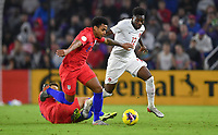 ORLANDO, FL - NOVEMBER 15: Weston McKennie #8 of the United States and Alphonso Davies #12 of Canada battle for ball during a game between Canada and USMNT at Exploria Stadium on November 15, 2019 in Orlando, Florida.