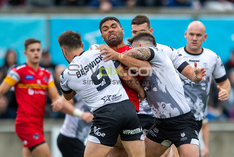 Picture by Kevin Sousa/SWpix.com - 07/10/2018 - Rugby League - Betfred Super League - The Qualifiers - Million Pound Game - Toronto Wolfpack v London Broncos - Lamport Stadium, Toronto, Canada - Mark Ioane #16 of the London Broncos is tackled by Robert Beswick #9 of the Toronto Wolfpack.