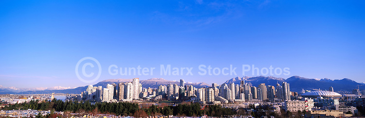 "City of Vancouver Downtown and Yaletown Skyline at ""False Creek"", BC, British Columbia, Canada, in Spring.  The North Shore Mountains (Coast Mountains) rise above the City. - Panoramic View"