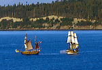 The tall ships Hawaiian Chieftan (l) and the Lady Washington square off in a mock battle in Port Townsend Bay during the 31st Wooden Boat Festival in Port Townsend, Washington.