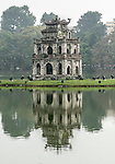 The Turtle Tower, built in 1886, stands on a small island in Hoan Kiem Lake, a central feature of Hanoi located in the old quarter of the city.