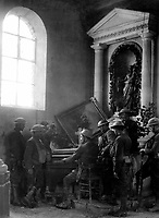 Squad of American soldiers listening to one of their comrades playing the organ in the half-wrecked old church in Exermont, in the Argonne.  France, October 11, 1918.  Sgt. J.A. Marshall. (Army)<br /> NARA FILE #:  111-SC-27413<br /> WAR & CONFLICT BOOK #:  653