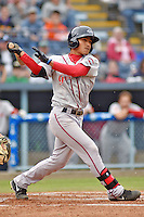 Greenville Drive shortstop Tzu-Wei Lin #36 swings at a pitch during a game against the  Asheville Tourists at McCormick Field on May 17, 2014 in Asheville, North Carolina. The Tourists defeated the Drive 14-6. (Tony Farlow/Four Seam Images)