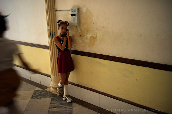 "A schoolgirl uses a public telephone inside the ""Escuela Nacional Cubana de Ballet,"" Cuban National Ballet School, in Havana, Cuba on Nov. 5, 2010."