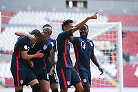 Jesus Ferreira #9 of the United States celebrates scoring with teammates