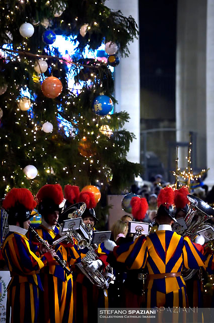 band Swiss Guards Pope Francis prays in front of a Nativity scene in St Peter's square at the Vatican  on December 31, 2016