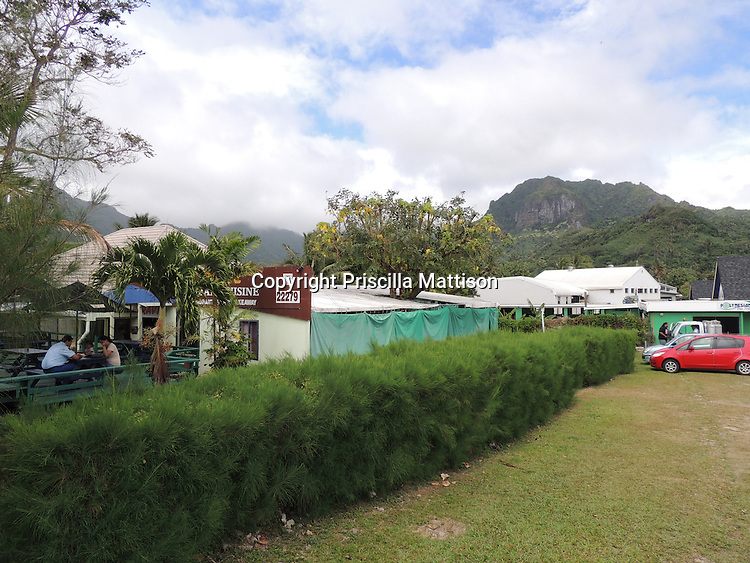 Rarotonga, Cook Islands - September 21, 2012:  An outdoor eating area has a backdrop of volcanic peaks.
