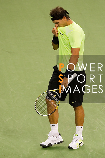 SHANGHAI, CHINA - OCTOBER 14:  Rafael Nadal of Spain reacts after loosing a point against Jurgen Melzer of Austria during day four of the 2010 Shanghai Rolex Masters at the Shanghai Qi Zhong Tennis Center on October 14, 2010 in Shanghai, China.  (Photo by Victor Fraile/The Power of Sport Images) *** Local Caption *** Rafael Nadal