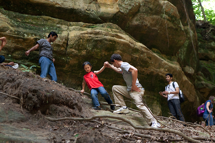 My husband helps our older son, age seven, climb up a canyon wall during a family vacation to Starved Rock State Park in Oglesby, Ill.