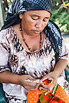"Middle-aged Wayuu indigenous woman knitting a ""mochila"" or shoulder bag.  Knitting, crocheting and weaving are fundamental to the social and economic lives of Wayuu women in La Guajira, Colombia."