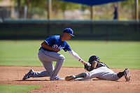 Los Angeles Dodgers second baseman Marcus Chiu (22) applies a tag on a stolen base attempt during an Instructional League game against the Chicago White Sox on September 30, 2017 at Camelback Ranch in Glendale, Arizona. (Zachary Lucy/Four Seam Images)