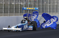 Feb. 15, 2013; Pomona, CA, USA; NHRA top fuel dragster driver T.J. Zizzo during qualifying for the Winternationals at Auto Club Raceway at Pomona. Mandatory Credit: Mark J. Rebilas-