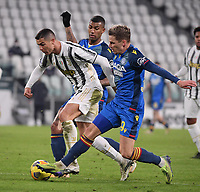 3rd January 2021, Allianz Stadium, Turin Piedmont, Italy; Serie A Football, Juventus versus Udinese; Cristiano Ronaldo of Juventus vies with Jens Stryger Larsen  of Udinese during a Serie A match between FC Juventus and Udinese